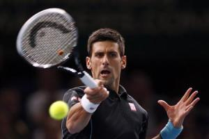Djokovic of Serbia hits a returns to Herbert of France during the Paris Masters in Paris