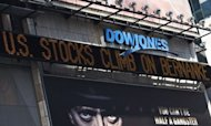 "The Dow Jones news-ticker in Times Square reads ""US Stocks climb on Bernanke's speech"" in New York City. Bernanke expressed deep worry over the US economy and unemployment Friday, sending a strong signal that he wants the central bank to take fresh action to stimulate growth"
