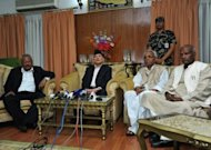 Nepalese Prime Minister Baburam Bhattarai (2nd left) answers questions during a press conference in Kathmandu on May 27. The leader of Nepal&#39;s Maoists has called for rival parties to join a national unity government to take the country to fresh elections and said he was open to a change of prime minister