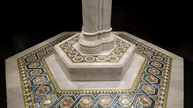"""In this Thursday, Oct. 25 2012 photo, a detail of the Baptismal font from Christ Church, Pomfret, Conn., is photographed while on display at the """"Louis C. Tiffany and the Art of Devotion"""" exhibit at the Museum of Biblical Art in New York.  (AP Photo/Mary Altaffer)"""