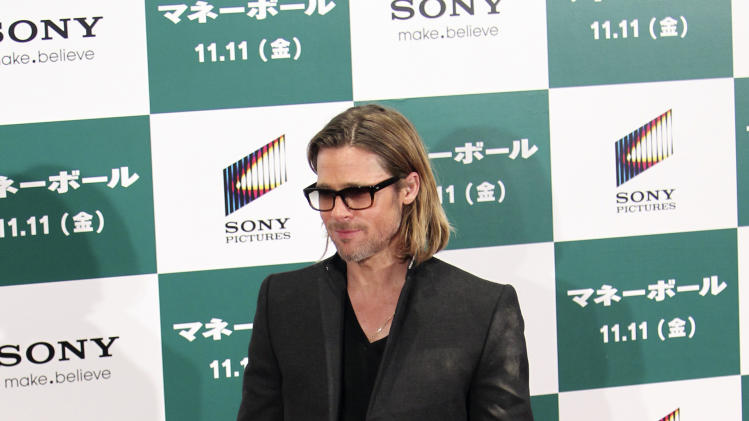"Actor Brad Pitt poses of the red carpet prior to the Japan premiere for his latest film ""Moneyball"" in Tokyo Wednesday, Nov. 9, 2011. (AP Photo/Junji Kurokawa)"