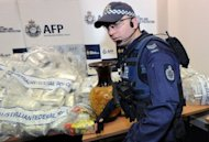 Australian Federal Police guard US$525 million worth of crystal methamphetamine (&#39;ice&#39;) and heroin after smashing a Hong Kong-based international drugs syndicate in Sydney on July 31, 2012