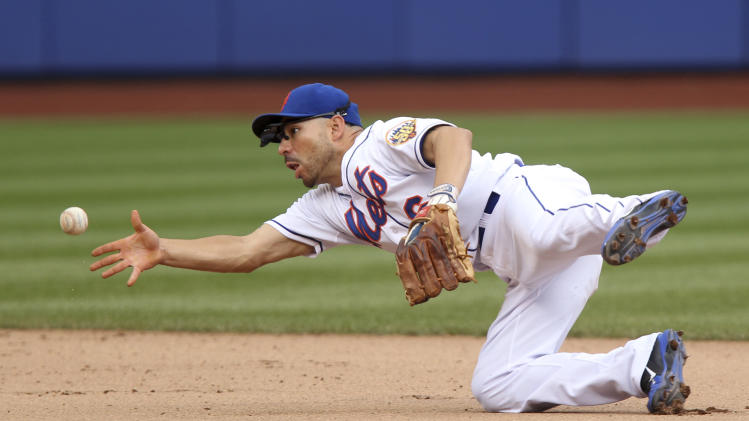 New York Mets shortstop Omar Quintanilla throws late to second base, trying to get St. Louis Cardinals' Daniel Descalso out, after bobbling the ball during the seventh inning of the baseball game against the St. Louis Cardinals Monday, June 4, 2012, at Citi Field in New York.  (AP Photo/Seth Wenig).