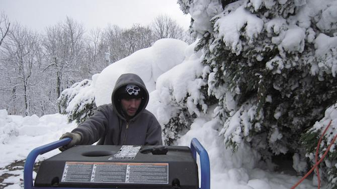 Garrett Colmer works on a generator outside his stepfatherís home in unincorporated Finzel, near Frostburg, Md., on Wednesday, Oct. 31, 2012. The vast majority of homes in mountainous, western Maryland Garrett county lost power after superstorm Sandy dumped more than 2 feet of snow in the area. (AP Photo/David Dishneau)