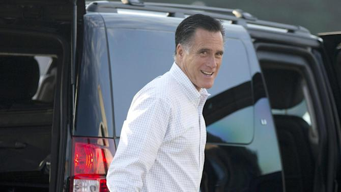 Republican presidential candidate, former Massachusetts Gov. Mitt Romney boards his campaign plane for an event in Iowa on Friday, Sept. 7, 2012 in Portsmouth, N.H.  (AP Photo/Evan Vucci)