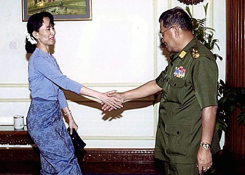 FILE - In this undated photo published Saturday, July 5, 2003 on the website of the official New Light of Myanmar newspaper, Myanmar opposition leader Aung San Suu Kyi, left,  meets junta leader Senior Gen. Than Shwe. (AP Photo/New Light of Myanmar)