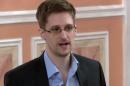 FILE - In this file image made from video released by WikiLeaks on Oct. 11, 2013, former National Security Agency systems analyst Edward Snowden speaks in Moscow. Faced with congressional inaction to curtail the NSA?s bulk collection of Americans? telephone records, civil liberties groups are looking to cases already in the courts as a quicker way to clarify just what surveillance powers the government should have. Three appeals courts are hearing challenges to the National Security Agency phone records program, creating the potential for an eventual Supreme Court review. Judges in lower courts are grappling with the admissibility of evidence gained through the NSA?s warrantless surveillance. The flurry of activity follows revelations last year by former contractor Edward Snowden of once-secret intelligence collection programs. (AP Photo, File)