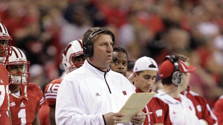 FILE - In this Dec. 1, 2012, file photo, file photo, Wisconsin coach Bret Bielema watches from the sideline during the first half of the Big Ten championship NCAA college football game against Nebraska in Indianapolis. . A person familiar with the situation tells The Associated Press on Tuesday, Dec. 4, 2012, that Bielema has agreed to become the new coach at Arkansas.  (AP Photo/AJ Mast, File)