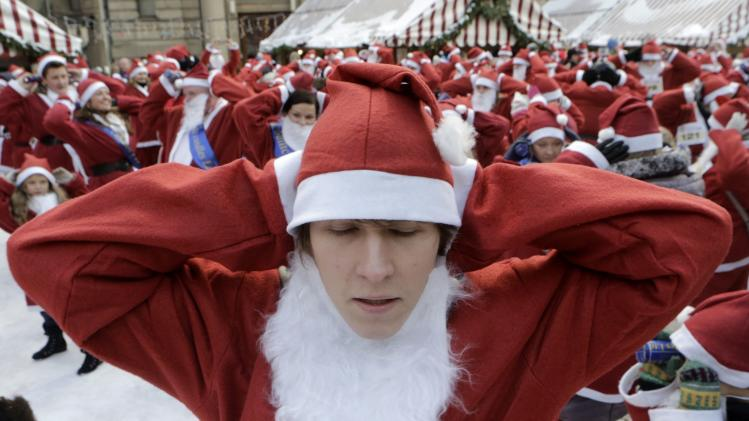 "Revellers dressed as Santa Claus warm-up before the ""Santa's Fun Run"" event in Riga"