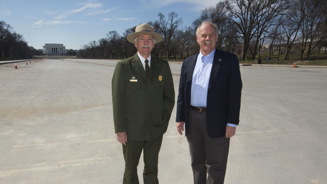 """In this Monday, March 23, 2015 photo, National Park Service Director Jonathan Jarvis, left, and the head of the National Park Foundation Dan Wenk stand in an empty Lincoln Memorial Reflecting Pool on the National Mall in Washington. With its centennial approaching in 2016, the park service will launch a major campaign Thursday, April 2 in New York City to raise support and introduce a new, more diverse generation of millennials and children to """"America's best idea,"""" the national parks. (AP Photo/Pablo Martinez Monsivais)"""