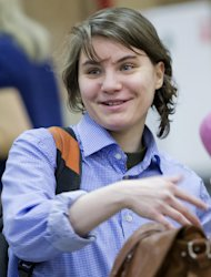 Member of the Pussy Riot punk band Yekaterina Samutsevich smiles as she attends a session at the Moscow City Court where she is appealing to overturn a court&#39;s decision to ban the video of the band&#39;s &quot;punk prayer&quot; in Moscow&#39;s main cathedral as &quot;extremist&quot;, Russia, Thursday, Jan. 24, 2013. Samutsevich was one of the three band members sentenced to two years in jail in August after their performance last February at Moscow&#39;s Christ the Savior cathedral. She was later released on appeal. (AP Photo/Misha Japaridze)