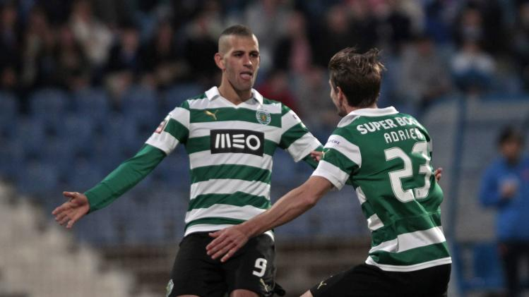 Sporting's Adrien Silva (23) celebrates his goal against Belenenses with teammate Islam Slimani during their Portuguese Premier League soccer match at Restelo stadium