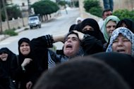 Syrian relatives mourn during funeral of Syria's violence victim, Mohammed Ahmed Rahim, in Qorqania village, north of Idlib province