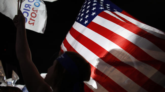 Pro-statehood New Progressive Party supporters waves a U.S. flag at the party's closing election campaign rally in San Juan, Puerto Rico, Saturday, Nov. 3, 2012. Voters in the U.S. Commonwealth of Puerto Rico will go the polls on Tuesday, Nov. 6 to weigh in on whether to change the status of their relationship with the United States, the island's central political dilemma, or to leave it unchanged. The two-part referendum is intended to send a message to the U.S. government and resolve a 114-year-old conundrum. (AP Photo/Ricardo Arduengo)