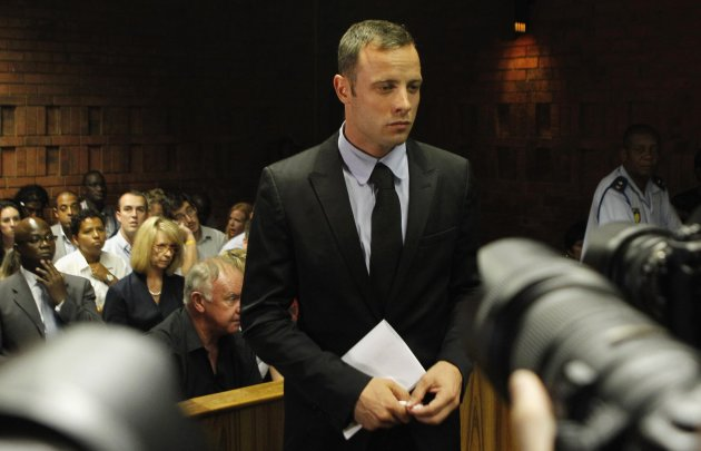 Pistorius stands in the dock during a break in court proceedings at the Pretoria Magistrates court