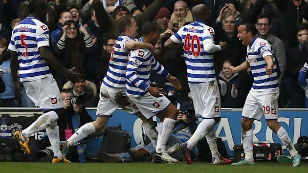 Queens Park Rangers' Andros Townsend (R) celebrates with team mates after scoring against Sunderland during their English Premier League match in London March 9, 2013. REUTERS