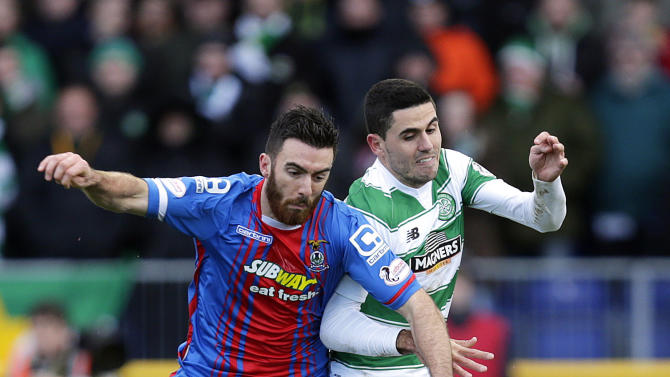 Inverness Caledonian Thistle's Ross Draper (L) in action with Celtic's Tom Rogic