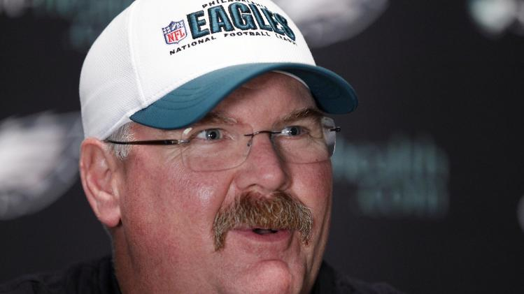 FILE - This Oct. 26, 2011 file photo shows Philadelphia Eagles head coach Andy Reid speaking during a media availability at their NFL football training facility in Philadelphia. Reid and the Kansas City Chiefs should be quite familiar by now. The two sides spent much of Thursday, Jan. 3, 2013 in negotiations for Reid to become the Chiefs' coach, a person familiar with the situation told The Associated Press. The person spoke to the AP on condition of anonymity because he wasn't authorized to discuss the situation. (AP Photo/Alex Brandon, File)