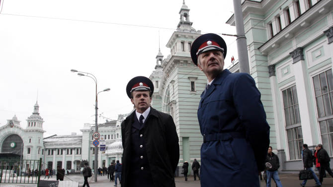 Two Russian Cossacks watch pedestrians passing by as they patrol Belorussky railway station in downtown Moscow, Russia, Tuesday, Nov. 27, 2012. Renowned for their sword-fighting prowess and anti-Semitism in czarist Russia, the Cossacks are taking on new foes: beggars, drunks, unlicensed traders and improperly parked cars. (AP Photo/Pavel Golovkin)