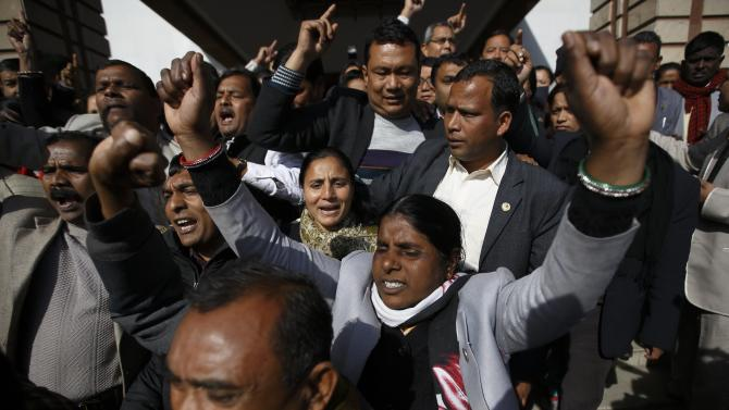 Constitution assembly members of an opposition party walk out as they shouts slogans after a meeting at the parliament in Kathmandu