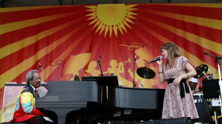 Theresa Andersson and Allen Toussaint perfrom a duet at the New Orleans Jazz and Heritage Festival in New Orleans, Saturday, May 5, 2012. (AP Photo/Gerald Herbert)