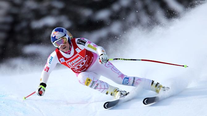 Lindsey Vonn of the United States speeds down the hill on her way to take the fourth place in an alpine ski, women's World Cup super-G, in St. Anton, Austria, Sunday, Jan. 13, 2013. (AP Photo/Marco Trovati)