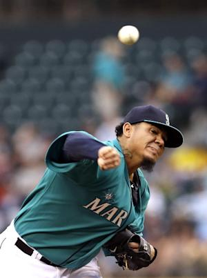 Hernandez, Morrison lead M's 12-3 rout of Red Sox