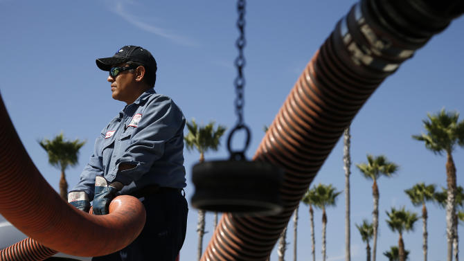 Rudy Rocha delivers gas to a Costco gas station in Tustin, Calif., Friday, Oct. 5, 2012. A 20-cent jump overnight in California gas prices has put the state ahead of Hawaii for the nation's most expensive gas. (AP Photo/Jae C. Hong)