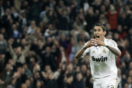 Real Madrid's Angel Di Maria from Argentina celebrates after scoring against Atletico de Madrid during his Spanish La Liga soccer match at the Santiago Bernabeu stadium, in Madrid, Spain, Saturday, Nov. 26, 2011. (AP Photo/Daniel Ochoa de Olza)