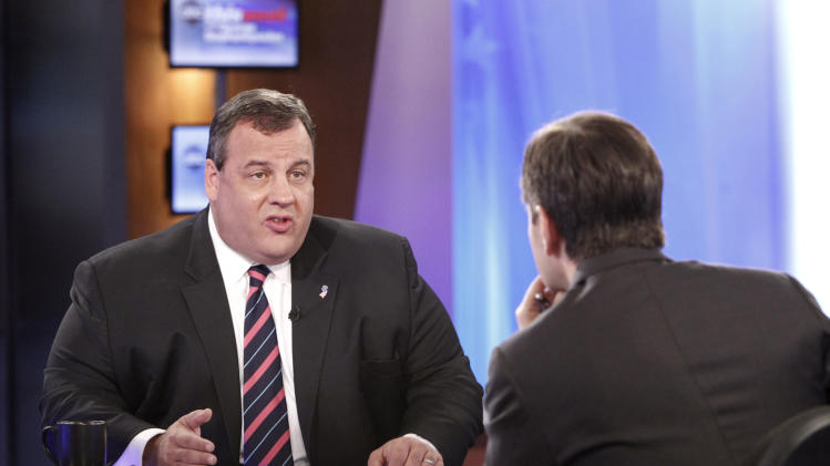 """In this photo provided by ABC News New Jersey Gov. Chris Christie responds to questions by ABC's """"This Week"""" host George Stephanopoulos at the ABC studio in New York Sunday, Sept. 30, 2012. Christie, who also appeared Sunday on another talk show predicted that Romney will do """"extraordinarily well"""" in the upcoming debate Wednesday night and that after that """"this whole race is going to be turned upside down."""" (AP Photo/ABC News, Lou Rocco)"""