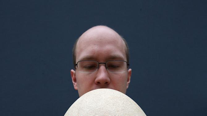 A Rare And Completely Fossilised Elephant Bird Egg On Display Ahead Of Auction At Christie's