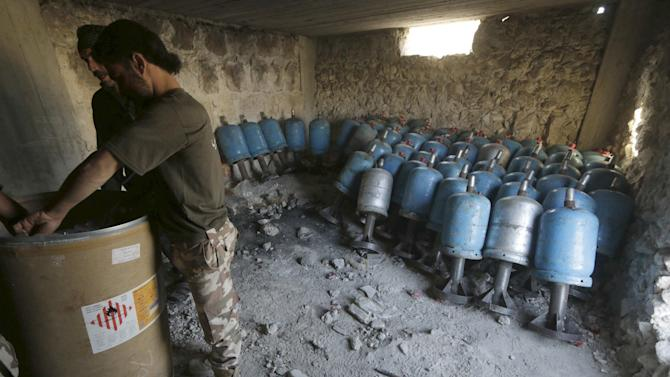 Rebel fighters prepare locally made shells during clashes with forces loyal to Syria's President Bashar al-Assad on the frontline of Aleppo's Sheikh Saeed neighbourhood