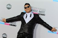 PSY arrives at the 40th Anniversary American Music Awards on Sunday, Nov. 18, 2012, in Los Angeles. (Photo by Jordan Strauss/Invision/AP)