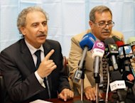 "Louai Hussein, the president of the group ""Building Syria"" (L) and Raja al-Nasser, long-time opponent to the government regime and General Secretary of the Coordinating Committee for Democratic National Change, give a press conference in the Syrian capital, Damascus"
