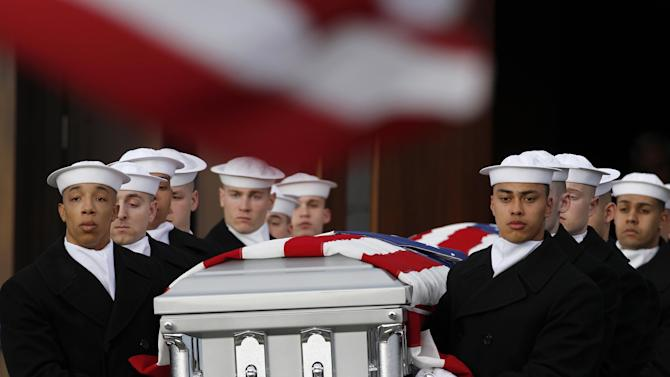 RETRANSMISSION TO CORRECT NAME OF CHAPEL - Two Navy Honor Guard teams carry two caskets of remains as they depart Fort Meyer Memorial Chapel during services to honor two sailors from the Civil War ship, the USS Monitor, Friday, March 8, 2013 in Arlington, Va. A century and a half after the Civil War ship the USS Monitor sank, two unknown crewmen found in the ironclad's turret were buried at Arlington National Cemetery. Friday's burial may be the last time Civil War soldiers are buried at the cemetery. (AP Photo/Alex Brandon)