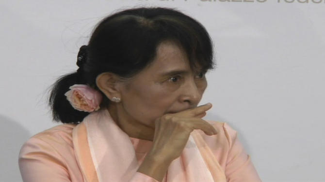 In this image taken from AP Television News Myanmar opposition leader Aung San Suu Kyi,  puts her hand to mouth before becoming ill at a press confernce in Bern, Switzerland, Thursday, June 14, 2012. Suu Kyi said she felt exhausted after her long trip from Asia to Europe. A spokesman for the Swiss Foreign Ministry said Suu Kyi recovered enough to briefly attend a reception with government officials but then retired to her room. Suu Kyi was her first trip to Europe since 1988. (AP Photo/AP Television News) TV OUT