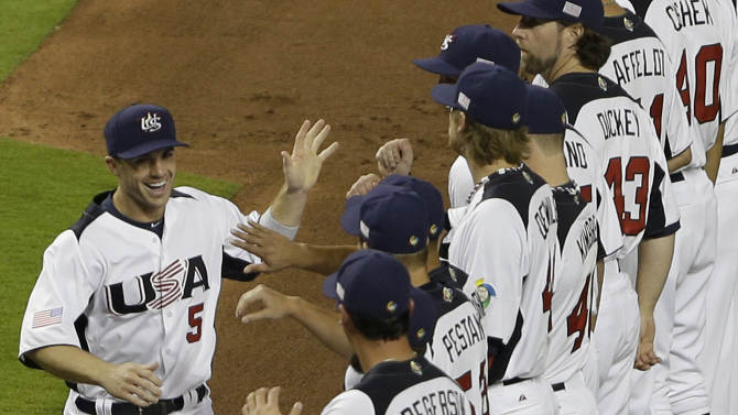 United States' David Wright (5) high fives teammates during the player introductions before the start of a second round World Baseball Classic game against Puerto Rico, Tuesday, March 12, 2013 in Miami. The U.S. defeated Puerto Rico 7-1. (AP Photo/Wilfredo Lee)
