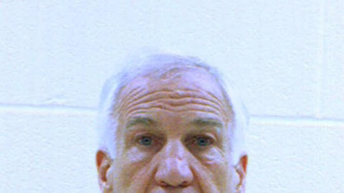 FILE - This file booking photo provided by the Centre County Correctional Facility in Bellefonte, Pa., shows former Penn State University assistant football coach Jerry Sandusky. Sandusky will be sentenced Tuesday, Oct. 9, 2012 for sexually abusing 10 boys in a scandal that rocked the university and brought down coach Joe Paterno. Because of who he is and what he's done, Sandusky could be in particular danger of sexual assault when he is sent off to prison this week. (AP Photo/Centre County Correctional Facility, File)