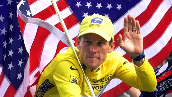 FILE - In this July 23, 2000, file photo, winner Lance Armstrong rides down the Champs Elysees after the final stage of the Tour de France cycling race in Paris. Armstrong also won the Prince of Asturias Award in Sports in 2000. Armstrong was stripped of his seven Tour de France titles and banned for life by cycling's governing body following a report from the U.S. Anti-Doping Agency that accused him of leading a massive doping program on his teams. (AP Photo/Laurent Rebours, File)