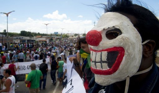 Protesters try to block access to the Castelao Stadium in Fortaleza, June 19, 2013