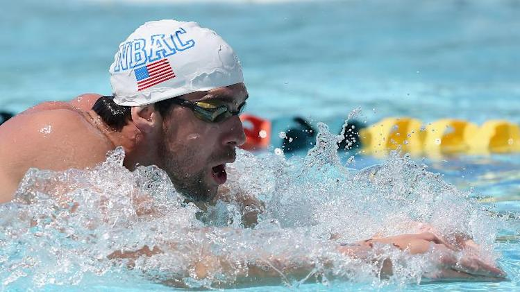 Michael Phelps warms up in the practice pool during day one of the Arena Grand Prix at the Skyline Aquatic Center on April 24, 2014 in Mesa, Arizona