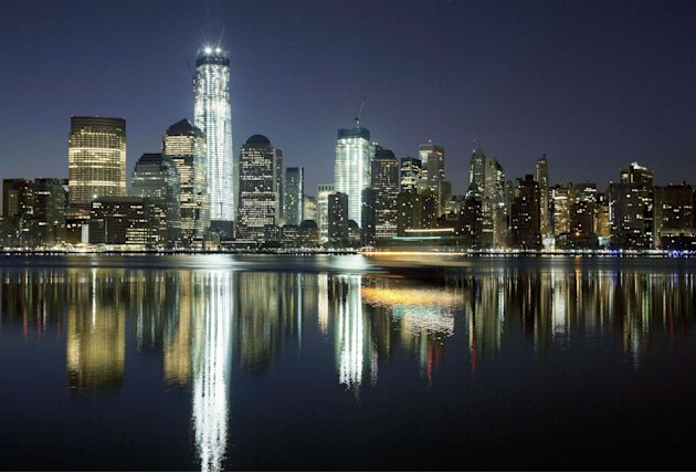 FILE - In this March 26, 2012, file photo, One World Trade Center towers above the Lower Manhattan skyline and Hudson River in New York. One World Trade Center, the giant monolith being built to repla