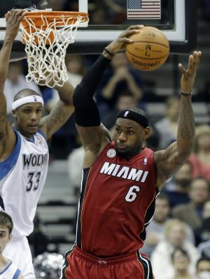 Miami Heat's LeBron James, right, beats Minnesota Timberwolves' Dante Cunningham in the second half of an NBA basketball game for one of his 10 rebounds Monday, March 4, 2013, in Minneapolis. The Heat won 97-81. (AP Photo/Jim Mone)