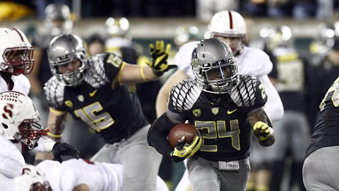 Oregon running back Kenjon Barner (24) finds running room during the first half of their NCAA college football game against Stanford in Eugene, Ore., Saturday, Nov. 17, 2012.(AP Photo/Don Ryan)