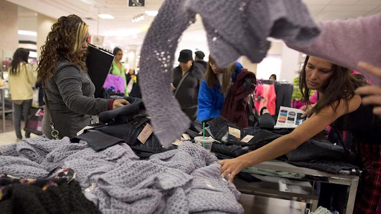 FILE -In this Friday, Nov. 23, 2012, file photo, shoppers rummage through a pile of sweaters on sale at a J.C. Penney store, in Las Vegas. U.S. consumer confidence rose this month to its highest level in almost five years, helped by a better outlook for hiring over the next six months. The Conference Board said Tuesday, Nov. 27, 2012, that its consumer confidence index rose to 73.7 in November from 73.1 in October. Both are the best readings since February 2008.  (AP Photo/Julie Jacobson)
