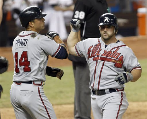 Uggla homers twice as Braves beat Marlins 11-0