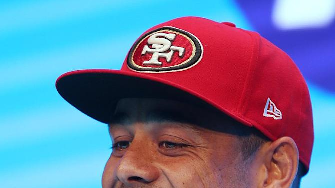 Jarryd Hayne smiles as he announces his free agent contract with the National Football League team the San Francisco 49ers at a press conference in Sydney, Tuesday, March 3, 2015. Australian rugby star Hayne has agreed to a contract with the San Francisco 49ers, a person with knowledge of the deal said Tuesday. (AP Photo/Rick Rycroft)