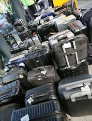 <p>The suitcases of striking Lufthansa flight attendants are seen at the airport in Frankfurt/M., western Germany. German flag carrier Lufthansa on Tuesday cancelled over 200 flights at its Frankfurt hub, Europe's third busiest, as a union chief threatened to hit every German airport with a 24-hour strike on Friday.</p>