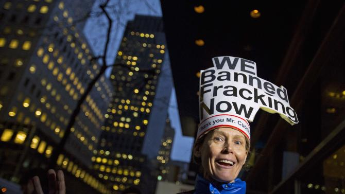 Fracking protesters cheer outside New York Governor Andrew Cuomo's office in New York