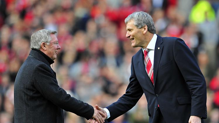 "Manchester United's Scottish manager Sir Alex Ferguson (L) shakes hands with Chief Executive David Gill (R) as he celebrates 25 years in charge before the English Premier League football match between Manchester United and Sunderland at Old Trafford in Manchester, north-west England on November 5, 2011. AFP PHOTO/GLYN KIRKRESTRICTED TO EDITORIAL USE. No use with unauthorized audio, video, data, fixture lists, club/league logos or ""live"" services. Online in-match use limited to 45 images, no video emulation. No use in betting, games or single club/league/player publications (Photo credit should read GLYN KIRK/AFP/Getty Images)"